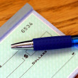 Portion of check with pen — Stock Photo #5048940