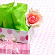 An empty feminine gift box with satin rose - Stock Photo
