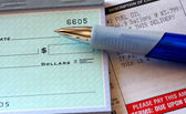 Fuel oil bill with pen and partial check — Foto de Stock
