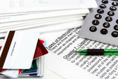 Bankruptcy document with bills, credit cards, calculator and pen — Stock Photo