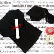 Graduation gown, mortarboard and diploma. - Lizenzfreies Foto