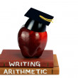 Textbooks with Apple and Mortarboard - Stock Photo