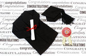 Graduation gown, mortarboard and diploma. — Stock Photo