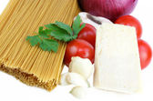 Whole Grain Pasta and Ingredients for Sauce on white. — Stock Photo