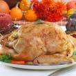Whole roasted turkey in Thanksgiving setting. — Stock Photo #5203880