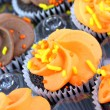 Royalty-Free Stock Photo: Fall decorated cupcakes in bakery tray.