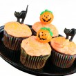 Decorated Halloween Cupcakes on White — Stock Photo #5209082