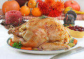 Whole roasted turkey in Thanksgiving setting. — Stock Photo