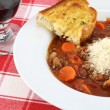 Minestrone Soup and garlic bread. - 图库照片