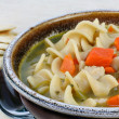 Hearty Chicken Noodle Soup with Carrots - Stock Photo