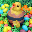 An Easter Chick Sitting in Jellybeans and Grass - Stock Photo