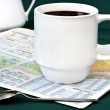 Coffee on Newspaper Weather Section — Stock Photo