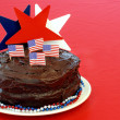 Chocolate cake with stars, flags and beads — Stock Photo #5225254