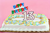 Birthday Cake with Number 13 Lit Candles — Stock Photo