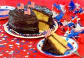 Chocolate Frosted Cake in Patriotic Setting — Stock Photo
