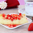 Strawberry Crepes in a feminine table setting. - Stock Photo