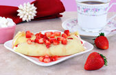 Strawberry Crepes in a feminine table setting. — Stock Photo