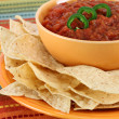 Salsa, jalapeno pepper slices and tortilla chips - Stock Photo