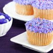 Purple cupcakes and jelly beans for Easter. - Stock Photo