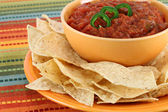 Salsa, jalapeno pepper slices and tortilla chips — Stock Photo