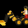 Stock Photo: Plastic toy mon toy tractor, isolation