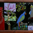 Panoramic image of ceramic panels with figures of birds and animals — Stock Photo