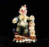 Figurine good funny clown with a small dog, isolated on black — Stock Photo