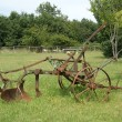 Antique plow at a farm in the summer field — Stock Photo