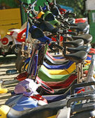 Several multi-colored scooters closeup — Stock Photo