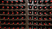 Wine Cellar, Bottles of wine in storage — Stock Photo