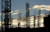 Silhouettes of construction workers, construction equipment and elements of — Stock Photo