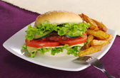 Hamburger with Fries and Fork — Stock Photo