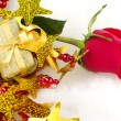 Red Rose and Golden Present — Stock Photo