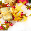 Royalty-Free Stock Photo: Golden Gift with Christmas Decoration