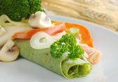 Rolled Thin Green Pancake — Stock Photo