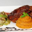 Stock Photo: Ribs with Vegetables and Sweet Potato Puree