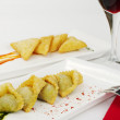 Appetizer: Empanada with Wine - Stock Photo