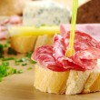 Baguette and Salami - Stock Photo