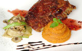 Ribs with Vegetables and Sweet Potato Puree — Stock Photo