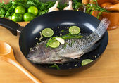 Raw Tilapia with Condiments in Frying Pan — Stock Photo