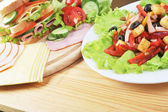 Sandwich and salad — Stock Photo
