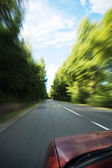 Car going fast — Stock Photo