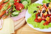 Sandwich and salad — Stock Photo