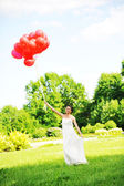 Bride with balloons — Stock Photo