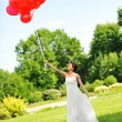Bride with balloons — Stock Photo #4675659