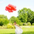 Bride with balloons — Stock Photo #4917166