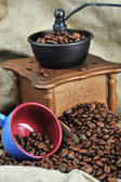 Coffee grinder and cup — Stock Photo