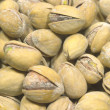 Many light brown ripe appetizing pistachios closeup — Stock Photo #4969101