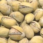 Many light brown ripe appetizing pistachios closeup — Stock Photo