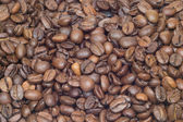 Many roasted coffee beans as background closeup — Stock Photo